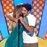 Tyler Posey hosts Teen Choice Awards, Reunites With J-Lo, Wears Hula Skirt